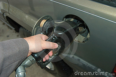 Pumping expensive gasoline into the car