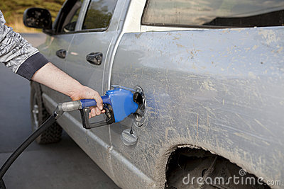 Pumping gas into a pickup truck