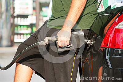 Pumping gasoline into a car