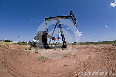 Pumpjack over oil well