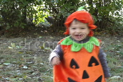 Pumpkin Baby goes and laughs stock video footage