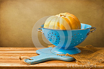 Pumpkin in blue colander