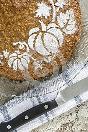 Pumpkin cake on glass plate and knife