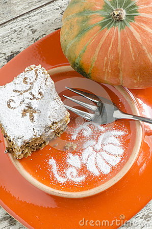Pumpkin cake on orange plate