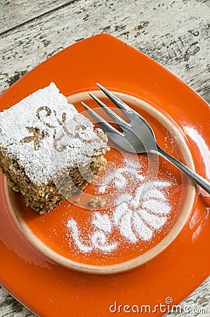 Pumpkin cake on orange plate and fork