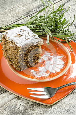 Pumpkin cake on orange plate with lavender lives