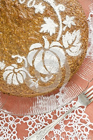 Pumpkin cake on red background