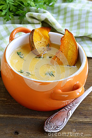 Pumpkin cream soup with pieces roasted pumpkin