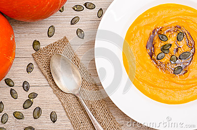 Pumpkin cream soup with seeds and oil