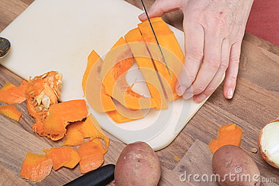 A Pumpkin is Cut to Slices