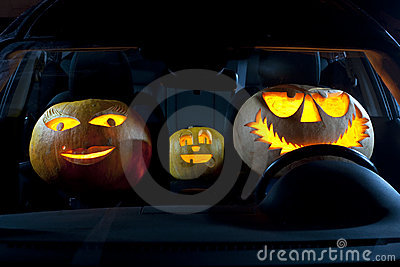 Pumpkin family in a car