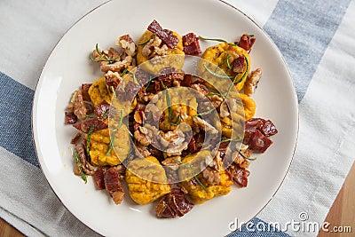 Pumpkin gnocchi with bacon Stock Photo