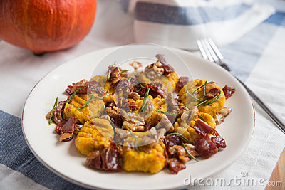 Pumpkin gnocchi with bacon Stock Photo