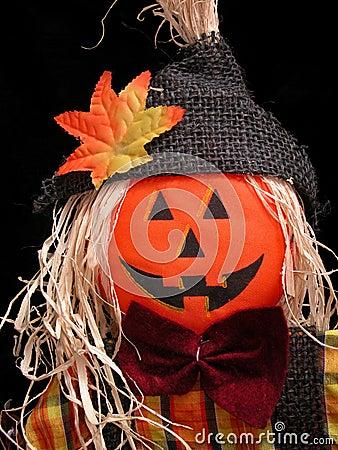 Pumpkin Headed Scarecrow on Black
