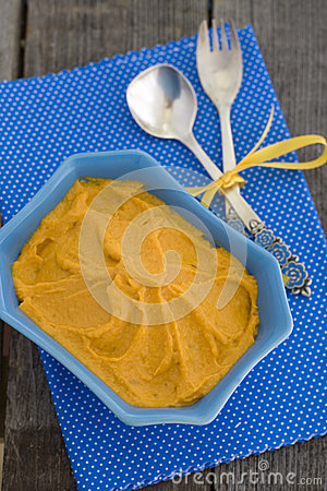 Pumpkin Hummus in a blue bowl