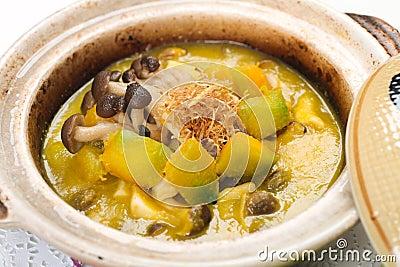 Pumpkin and mushroom stew in claypot
