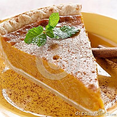 Pumpkin pie with mint garnish.