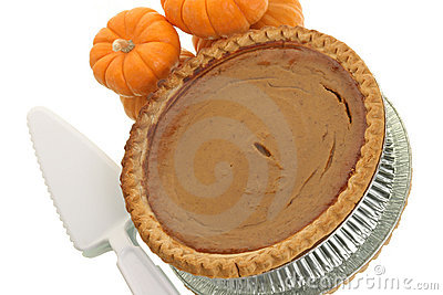 Pumpkin pie with serving utensil