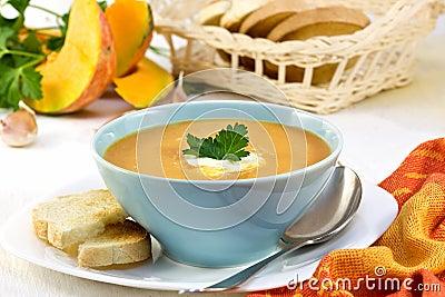 Pumpkin soup in a blue cup