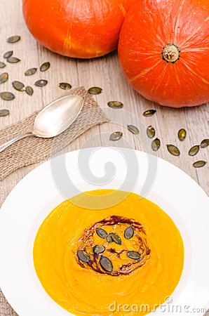 Pumpkin soup with seeds and oil
