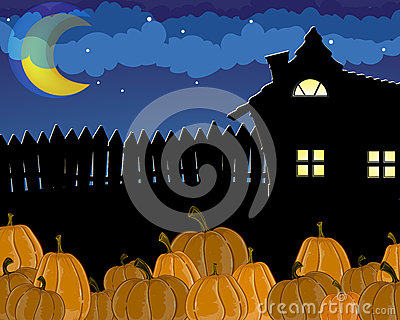 Pumpkins and house with glowing windows