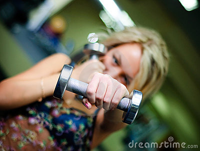 Punch with dumbbells.