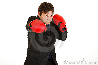 Punching furious businessman with boxing gloves