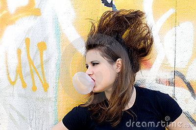 Punk girl blowing bubble gum
