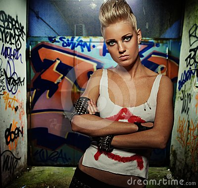 Free Punk Girl With Graffiti Painted Gateway Behind Her Stock Photos - 24453043