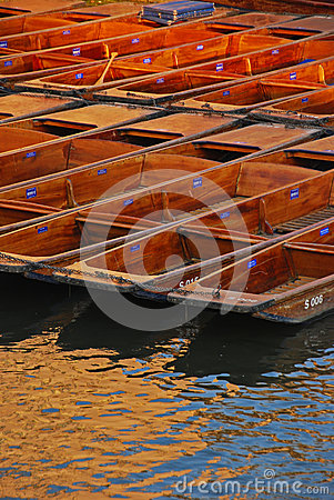 Punts Docked at Riverside in Cambridge