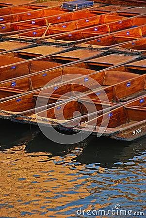 Punts Docked at Riverside in Cambridge