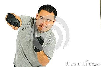 Punzone dell uomo nel combattimento del corpo
