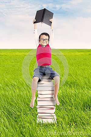Pupil with books outdoor