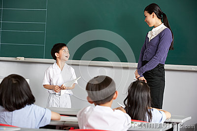 Pupil And Teacher In A Chinese School