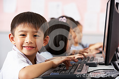 Pupil Using Keyboard During Computer Class