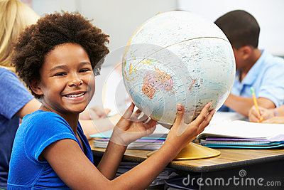 Pupils Studying Geography In Classroom