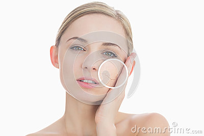 Pure woman touching her skin with close up of her wrinkles
