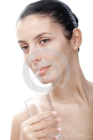 Pure young woman drinking water by straw