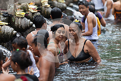 Purification in sacred holy spring water, Bali Editorial Photo