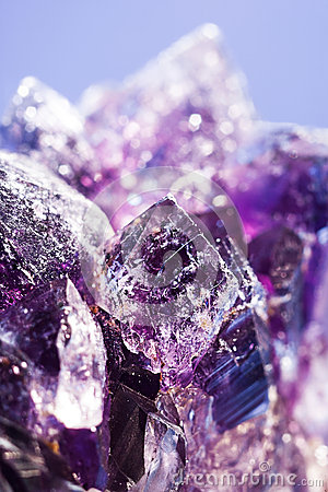 Purple amethyst stone over abstract background