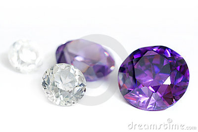 Purple and colorless gemstones close-up