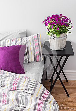 Free Purple Flowers In A Bright Bedroom Stock Image - 31393171