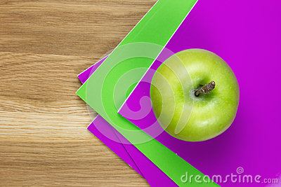Purple and green exercise-books
