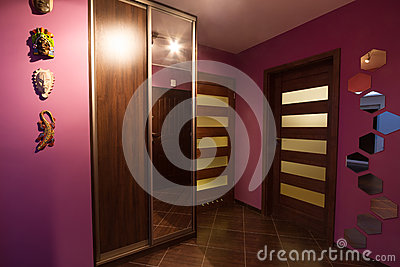 Purple hall with wardrobe