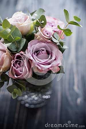 Free Purple, Mauve Color Fresh Summer Roses In Vase With Black Tablet Royalty Free Stock Images - 93603739