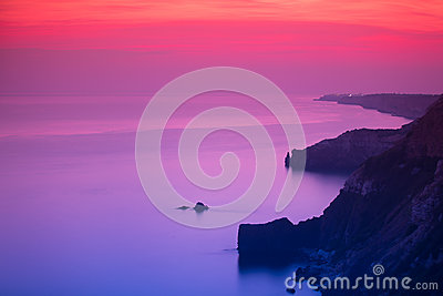 Purple and pink sunset over ocean