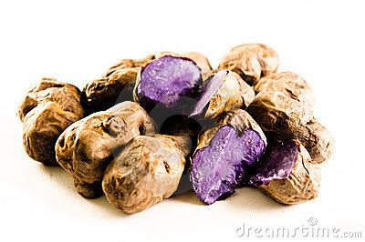 Purple potatos on white