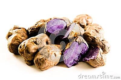 Purple potatos on white