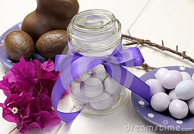 Purple theme Easter dinner, breakfast or brunch table setting, close-up.