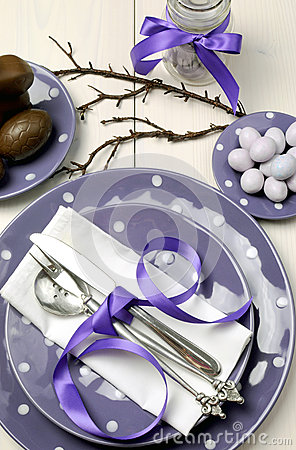 Purple theme Easter dinner, breakfast or brunch table setting, Vertical aerial view.